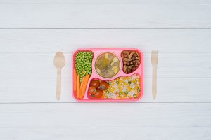 top view of tray with kids lunch for