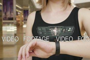 Young girl press on futuristic user