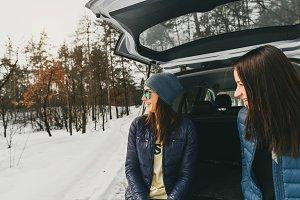 Girlfriends winter wear in the car