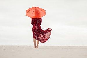 Woman under umbrella standing