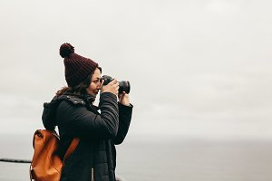 Woman traveler takes pictures