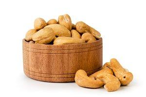 Fried cashew in wooden plate