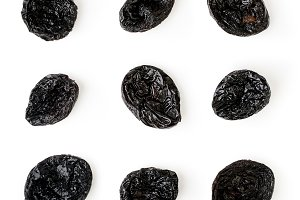 Prunes laid out on a white