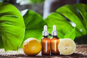Bottles with lemon oil, fresh  fruit