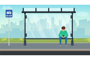 Man sitting alone at the bus stop