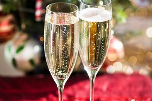 Two Champagne Flutes on Christmas Ba