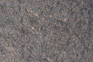 Gray volcanic sand, stone surface