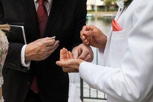 Groom Taking Ring From Pastor