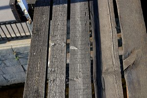 Weathered wooden planks footway