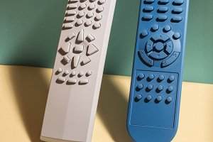 Colored TV remote controls on bright