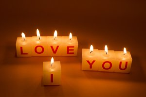 I Love You words on candle