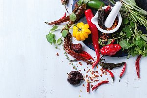 Assortment of chili peppers and herb