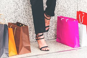 Woman legs with shopping bag