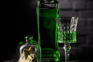 close-up shot of glass and bottle of