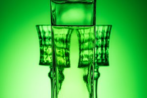 bottle of absinthe with glasses on m