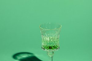 crystal glass of absinthe beverage o