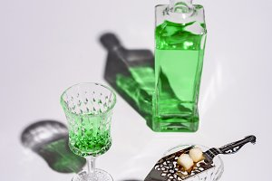 crystal glasses with absinthe spoon