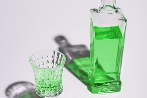 crystal glass and bottle of absinthe