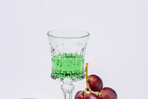 crystal glass of absinthe with branc