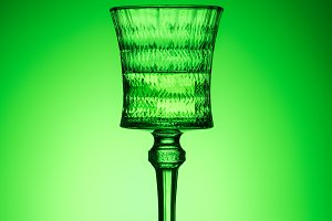 lead glass of absinthe on reflective