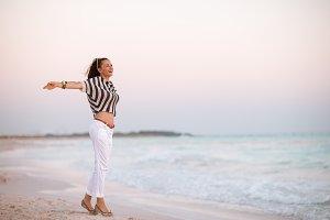 modern woman on beach at sunset rejo