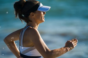 healthy woman jogger jogging against