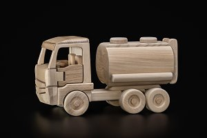 Toy, wooden car with fuel tank.