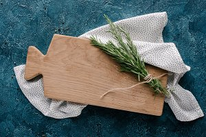 Wooden cutting board with rosemary h