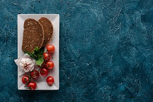 Plate with bread piece and red tomat
