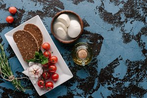 Plate with tomatoes an bread on dark