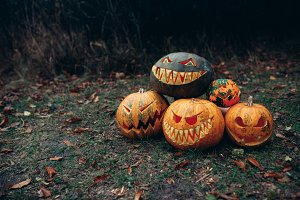Group of halloween pumpkins with a c