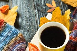 Autumn comfort. Mug of hot coffee wi