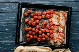 Baking pan with red cherry tomatoes