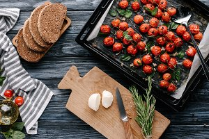 Pan with baked tomatoes and pieces o
