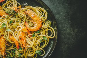 Spaghetti with pesto and prawns serv