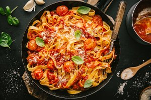 Tomato sauce spaghetti pasta on pan
