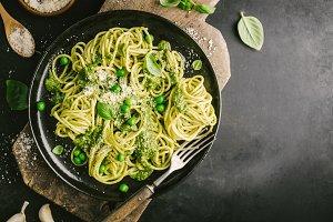 Tasty pasta with pesto served on pla