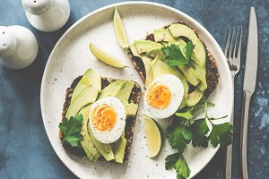 Healthy avocado toasts with egg