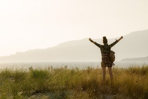 woman rejoicing against mountain and