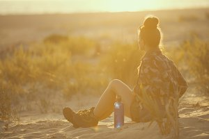 traveller woman with bottle of water