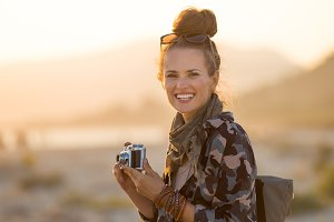 smiling adventure tourist woman with