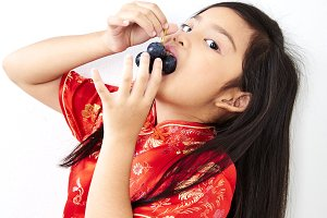girl with holding a Eating Grape bun