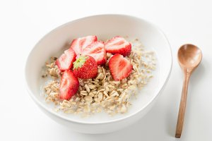 Oatmeal porridge in white bowl with