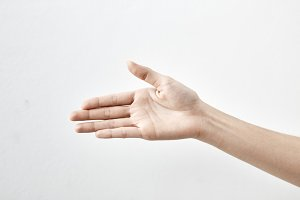 Female hand on white
