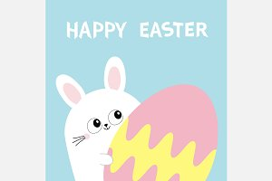 Happy Easter. Bunny rabbit with egg.