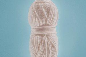 white knitting yarn ball with knitti