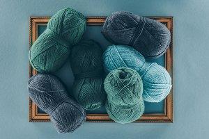 blue and green knitting wool balls o