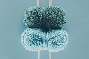 blue knitting yarn with knitting nee