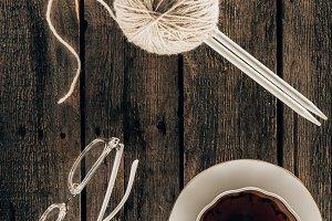top view of knitting needles, yarn,