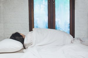 girl sleeps in the bedroom